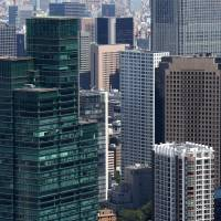 Top tier: Commercial and residential buildings in Tokyo are seen from an observatory in Mori Tower in Roppongi Hills on Sept. 3. | BLOOMBERG