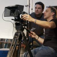 Hollywood producer Jim Bruce (left) and cinematographer Christopher Gallo confer during filming. Bruce made a tidy bundle shorting the financial stocks at the heart of the global financial meltdown and used that money to fund his documentary on the crisis. | LIBERTY STREET FILMS/THE WASHINGTON POST