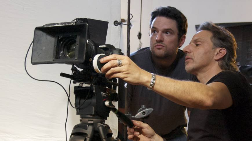 Hollywood producer Jim Bruce (left) and cinematographer Christopher Gallo confer during filming. Bruce made a tidy bundle shorting the financial stocks at the heart of the global financial meltdown and used that money to fund his documentary on the crisis.