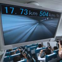 Practically flying: A monitor in the prototype maglev train developed by Central Japan Railway Co. (JR Tokai) shows a live view from the front of the train and its speed during a trial run in Tsuru, Yamanashi Prefecture, on Aug. 29. | BLOOMBERG