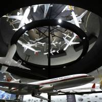 Back in the skies: Models of different Japan Airlines Co. aircraft are displayed in the company's maintenance center at Haneda airport in Tokyo in July. | BLOOMBERG