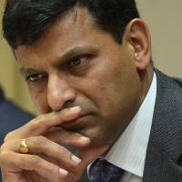 First step: Reserve Bank of India Gov. Raghuram Rajan pauses at a news conference at RBI headquarters in Mumbai on Friday. | AFP-JIJI