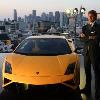 Cut above: Lamborghini CEO Stephan Winkelmann unveils the Gallardo LP 570-4 Squadra Corse sports car at the Lamborghini Aoyama dealership in Tokyo on Friday. | BLOOMBERG