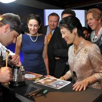 Understated: Princess Hisako (second from right) watches a craftsman demonstrate his skills as S.T. Dupont President Alain Crevet (far right), French Princess Tania de Bourbon Parme (second from left) and others look on at the French Embassy in Tokyo on Wednesday night. | YOSHIAKI MIURA