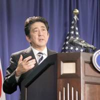 You know what I mean: Prime Minister Shinzo Abe holds a news conference at the InterContinental hotel on Friday in New York. | AP