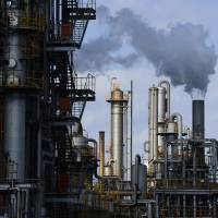 Losing it: Steam rises from a plant in the Keihin Industrial Area in Kawasaki on Sunday. Data released Monday showed that industrial production fell 0.7 percent in August. | BLOOMBERG
