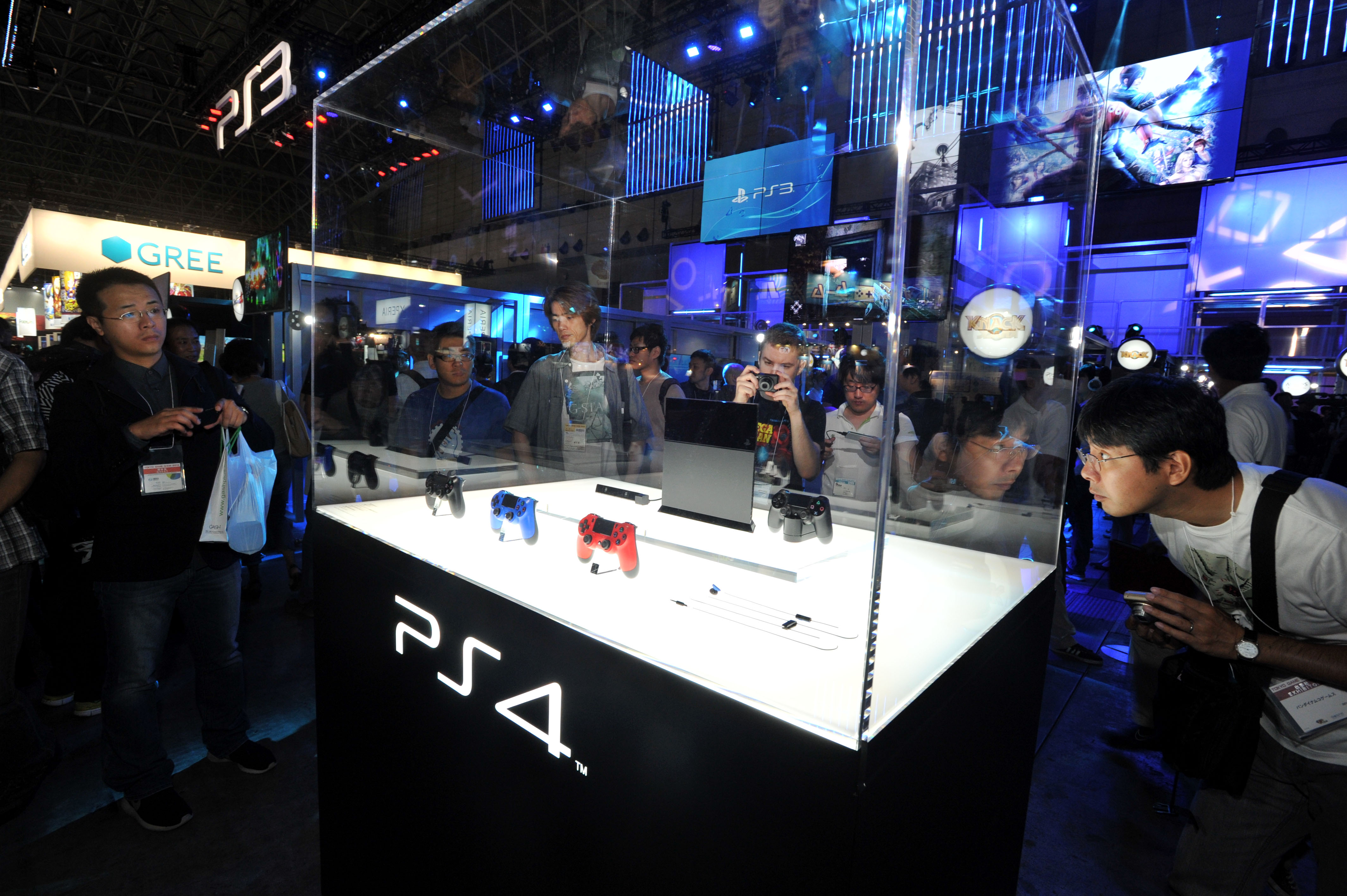 First look: People gather around a model of Sony's new PlayStation 4 console at Tokyo Game Show in Chiba on Thursday. | YOSHIAKI MIURA
