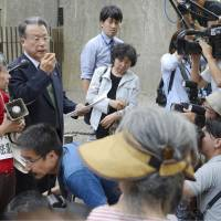 Enjoy the moment: Hiroshi Okamoto, a lawyer representing a group of inheritance rights plaintiffs, speaks to their supporters outside the Supreme Court on Wednesday. | KYODO