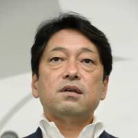 Osprey briefing: Defense Minister Itsunori Onodera speaks to reporters Friday in Tokyo. | KYODO