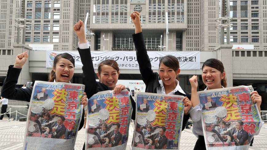 Thrilled: College students, showing their excitement that Tokyo was chosen to host the 2020 Olympic Games, hold up four-page extra editions of Sports Nippon newspaper on Sunday morning outside of the Tokyo Metropolitan Government Building in Shinjuku Ward. Other newspapers also distributed free commemorative editions in Tokyo.    YOSHIAKI MIURA
