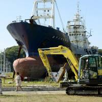 Shore duty over: Work begins Monday to dismantle the Kyotoku Maru No. 18, a fishing vessel that was washed ashore by the March 2011 tsunami. | KYODO