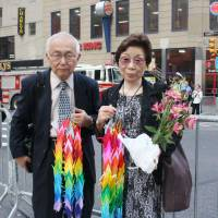 Remembering: Kazusada and Mari Sumiyama, who lost their son Yoichi Sugiyama in the Sept. 11, 2001, attacks on the United States, is seen near the former site of the World Trade Center in New York on Wednesday. | KYODO
