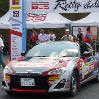 Pep rally: Racing buffs check out the car that was driven by Toyota Motor Corp. President Akio Toyoda during the Toyota Racing Development Rally Challenge in Shibukawa, Gunma Prefecture. | KYODO