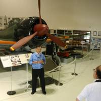 One of a kind: Takashi Amano, head of the archives room at Mitsubishi Heavy Industries' Komaki-Minami plant, tells visitors about the Imperial Japanese Navy's Zero fighter plane.   CHUNICHI SHIMBUN
