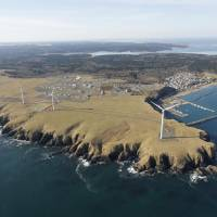 No nuclear threat: A group of windmills on the tip of the Nemuro Peninsula in eastern Hokkaido is considered one of Japan's major renewable energy facilities, but the momentum for expanding clean power generation is being eroded by financial considerations. | KYODO