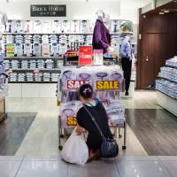 Spend or save?: Shoppers check out shirts at a store beneath Tokyo station on Sept. 8. | BLOOMBERG