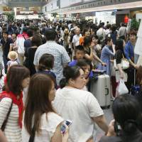 On the final day of a three-day vacation period, would-be travelers are grounded in Tokyo's Haneda airport as numerous flights are cancelled and rescheduled.    KYODO