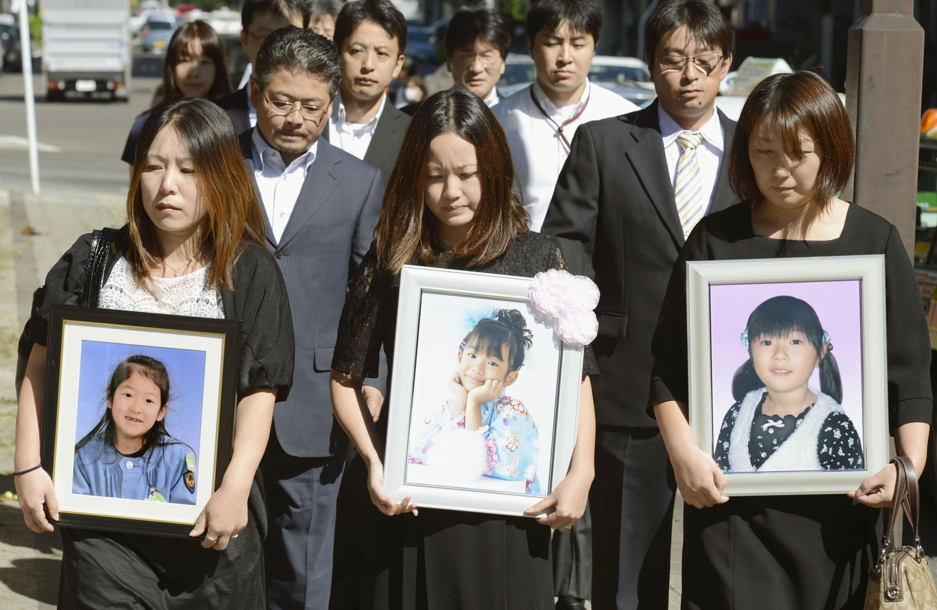 Judgment: Mothers of girls killed when their school bus was swamped by the 2011 tsunami enter the Sendai District Court on Tuesday. The court ordered the kindergarten that operated the bus to pay ¥177 million in damages.   KYODO