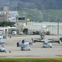 On the flight line: MV-22 Osprey tilt-rotator aircraft sit on the tarmac at U.S. Marine Air Station Futenma in Ginowan, Okinawa Prefecture, last month. | KYODO