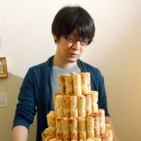 Eat, pray, love: Koshi Kawachi displays statues of the Buddha that he carved out of 'umaibo' snacks. | KYODO