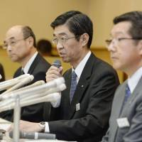 Facing the music: Hokkaido Railway Co. President Makoto Nojima faces the press at the railroad's headquarters in Sapporo Sunday to field questions about track repair problems. | KYODO
