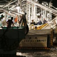 Heading out: Fishermen in Fukushima Prefecture leave the port of Matsukawaura on Wednesday, resuming trial operations that were suspended by radioactive water leaking from the No. 1 nuclear plant into the sea.   KYODO