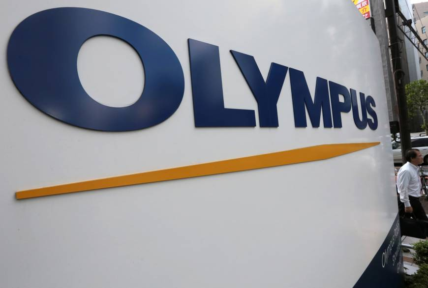 Olympus reaches first shareholder settlement over accounting scandal