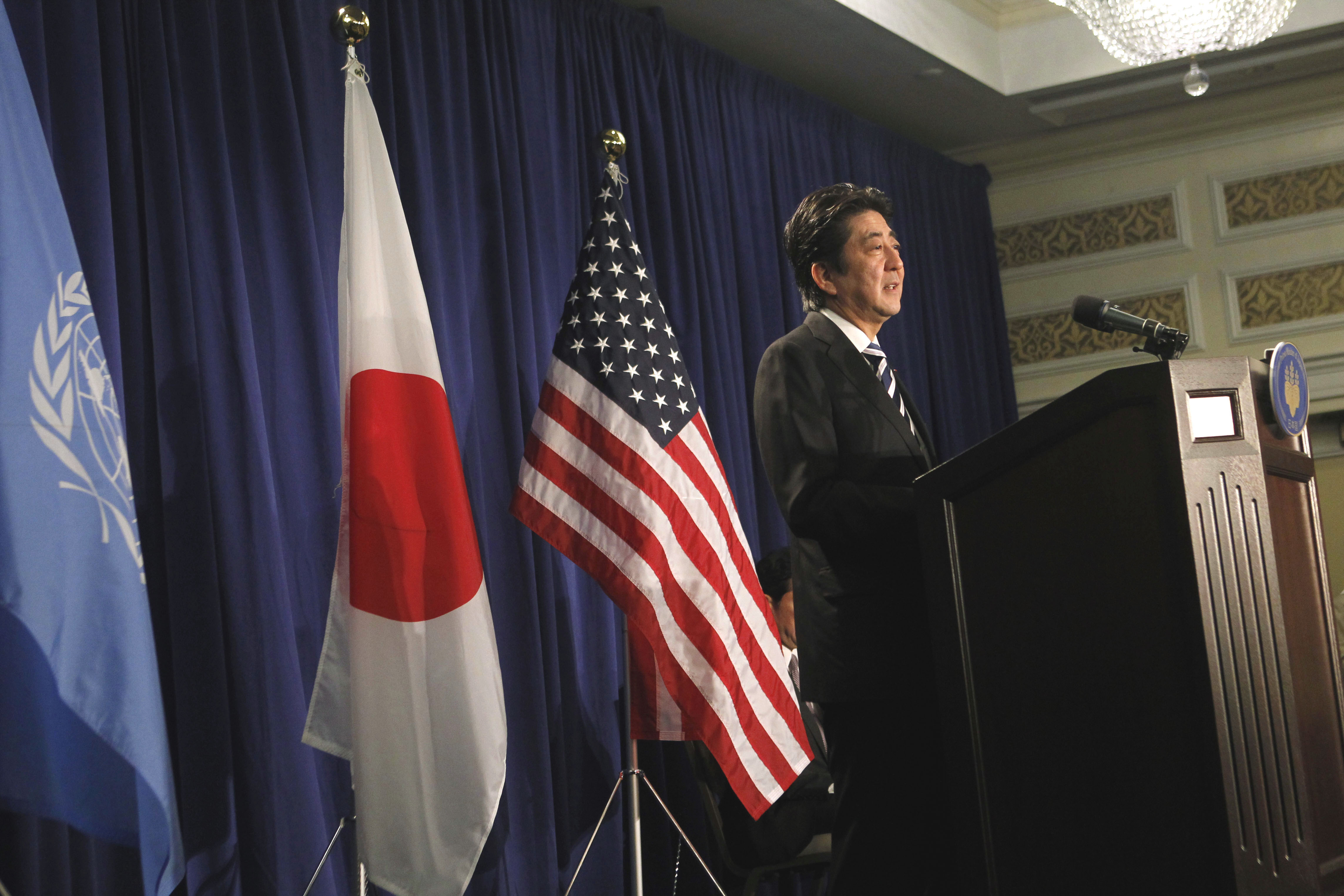 Redefining pacifism: Prime Minister Shinzo Abe, seen holding a news conference in New York on Friday, returned to Tokyo on Saturday afternoon after a five-day trip to North America. | AP