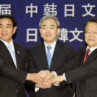 Cultured bunch: Culture minister Hakubun Shimomura (left) and his South Korean and Chinese counterparts, Yoo Jin-ryong (center) and Cai Wu, pose for a group photo after their trilateral meeting in Gwangju, South Korea, on Saturday. The three sides designated one city in each country as an East Asia City of Culture to further exchanges and mutual understanding next year. | KYODO