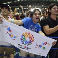 One more time: People celebrate after Tokyo is selected as the host city for the 2020 Olympic and Paralympic Games during a public viewing at Komazawa Olympic Park in Tokyo on Sept. 8.  | BLOOMBERG