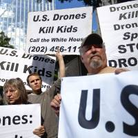 Killer craft: Demonstrators protest against the use of drones outside the International Conference on Unmanned Aircraft Systems at the Grand Hyatt in Atlanta in May.  | AP