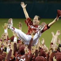 Historic triumph: The Rakuten Eagles toss manager Senichi Hoshino in the air during the doage after winning the Pacific League pennant with a 4-3 victory over the Seibu Lions on Thursday.   | KYODO