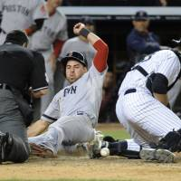 Decisive run: Boston's Jacoby Ellsbury scores on Shane Victorino's single against New York in the 10th inning on Thursday night. The Red Sox edged the Yankees 9-8. | AP