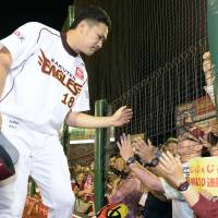 Local hero: Tohoku Rakuten Golden Eagles ace Masahiro Tanaka greets fans after winning his 24th straight decision on Friday in a 3-2 victory over the visiting Hokkaido Nippon Ham Fighters at Kleenex Stadium. | KYODO
