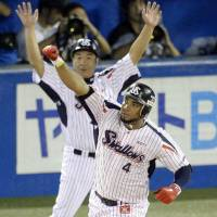 Hold that thought: Wladimir Balentien celebrates joining Sadaharu Oh, Tuffy Rhodes and Alex Cabrera with his record-tying 55th home run of the season on Wednesday.   KYODO