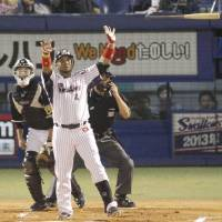 Just done it: Wladimir Balentien throws his bat in celebration after hitting his 56th home run of the season on Sunday.   KYODO