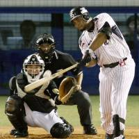 One more for luck: Wladimir Balentien extends his newly minted single-season home run record with his 57th of the year at Jingu Stadium on Sunday. | KYODO