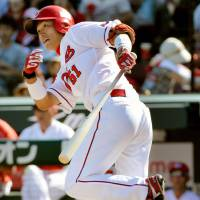 Run like the wind: Hiroshima rookie Seiya Suzuki takes off for first base after hitting a bases-loaded single in the fourth inning of the Carp's 5-4 win over the Giants on Monday. | KYODO