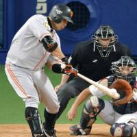 The man who can: Yomiuri's Shinnosuke Abe gets a hit during the third inning of the Giants' 3-2 win over the Dragons on Thursday. | KYODO