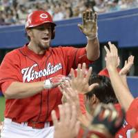 Ticket punched: The Carp's Brad Eldred celebrates after two-run homer in the eighth inning on Wednesday against the Dragons. Hiroshima won 2-0 to clinch it's first ever berth in the CL Climax Series. | KYODO