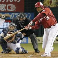 First time for everything: Tohoku Rakuten's Andruw Jones hits a two-out, bases-loaded double in the seventh inning of the Golden Eagles' 4-3 win over the Lions on Thursday night.   KYODO