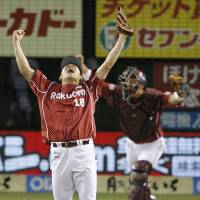 Jack of all trades: Tohoku Rakuten ace Masahiro Tanaka celebrates getting the final out in relief against the Lions on Thursday night.   KYODO