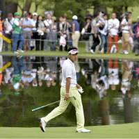 Solid work: Hideki Matsuyama, who shot a 5-under 66 in the third round, walks the course at Fujizakura Country Club on Saturday. The 21-year-old holds a four-stroke lead entering the final round at the Fujisankei Classic. | KYODO