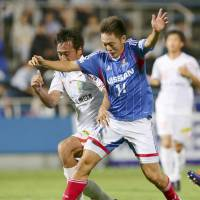 Easy does it: Yokohama F. Marinos forward Manabu Saito (right) takes on the Vanraure Hachinohe defense during his side's 5-1 Emperor's Cup second-round win on Wednesday. | KYODO
