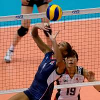 Make a move: Alisha Glass of the United States sets the ball against Japan on Sunday. | FIVB