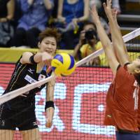 Good positioning: Japan's Saori Kimura taps the ball over the net against Vietnam during the Asian qualifying round for the FIVB World Championships on Thursday in Komaki, Aichi Prefecture. Japan defeated Vietnam 25-9, 25-16, 25-20. | KYODO