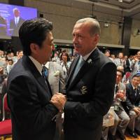 The finalists: Prime Minister Shinzo Abe is congratulated by Turkish Prime Minister Recep Tayyip Erdogan after IOC President Jacques Rogge announced on Saturday in Buenos Aires that Tokyo will host the 2020 Summer Olympics. | AFP-JIJI