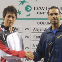 Meet and greet: Kei Nishikori (left) and Colombia's Alejandro Falla are scheduled to compete in the Davis Cup World Group Playoff on Friday at Ariake Colosseum.   KYODO