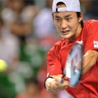 World in motion: Go Soeda plays a shot during his match against Alejandro Falla during Japan's Davis Cup World Group playoff against Colombia on Sunday. Japan won 3-2.   AFP-JIJI