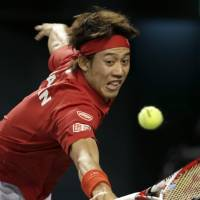 Ace in the hole: Kei Nishikori plays a shot during his 6-1, 6-2, 6-4 singles win over Santiago Giraldo on Sunday. | AP
